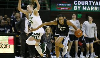 Connecticut forward Napheesa Collier (24) beats Baylor forward Lauren Cox (15) to the loose ball during the first half of an NCAA college basketball game on Thursday, Jan. 3, 2019, in Waco, Texas. (AP Photo/Ray Carlin)