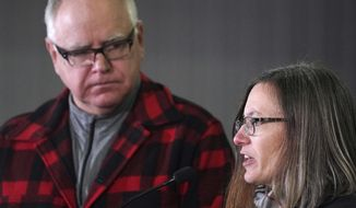 Sarah Strommen, currently an assistant commissioner at the Department of Natural Resources, answers questions after Gov.-elect Tim Walz announced she will lead the DNR, the first woman appointed, during a news conference Thursday, Jan. 3, 2019 at Bill Sorg's Dairy Farm in Hastings, Minn. (Anthony Souffle/Star Tribune via AP)