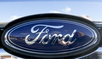 This Nov. 19, 2015 file photo shows the blue Ford oval badge in the grill of a pickup truck on the sales lot at Butler County Ford in Butler, Pa.  On Friday, Jan. 4, 2019, Ford is recalling more than 953,000 vehicles worldwide to replace Takata passenger air bag inflators that can explode and hurl shrapnel. The move includes 782,000 vehicles in the U.S. and is part of the largest series of recalls in U.S. history. (AP Photo/Keith Srakocic, File)