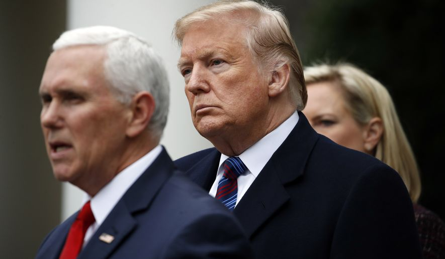 President Donald Trump listens as Vice President Mike Pence speaks in the Rose Garden of the White House after a meeting with Congressional leaders on border security, Friday, Jan. 4, 2019, at the White House in Washington, as Homeland Security Secretary Kirstjen Nielsen listens at right. (AP Photo/Jacquelyn Martin)