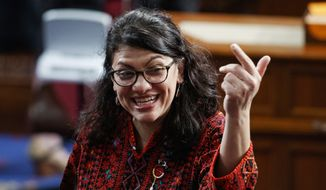 In this Thursday, Jan. 3, 2019, photo, then Rep.-elect Rashida Tlaib of Michigan, is shown on the house floor before being sworn into the 116th Congress at the U.S. Capitol in Washington. (AP Photo/Carolyn Kaster)