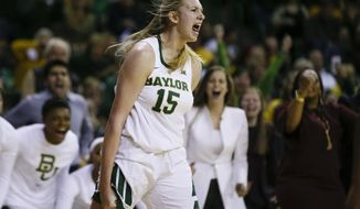 Baylor forward Lauren Cox (15) yells after making a basket and drawing a foul against Connecticut during the second half of an NCAA college basketball game Thursday, Jan. 3, 2019, in Waco, Texas. Baylor defeated No. 1 Connecticut 68-57. (AP Photo/Ray Carlin)