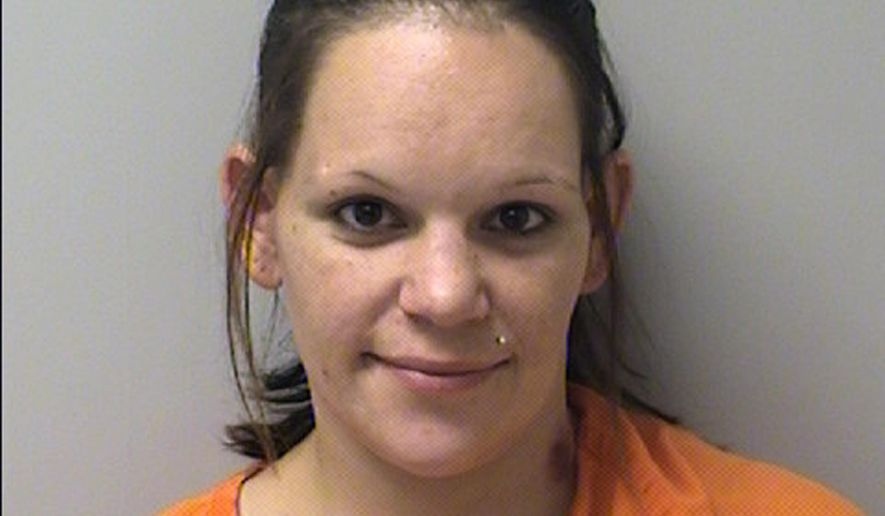 This undated booking photo released by Marathon County Sheriff's Office shows Marissa Tietsort of Wausau, Wis. The Wisconsin baby sitter accused of killing a 2-month-old boy has been charged with first-degree intentional homicide. A criminal complaint filed Friday, Jan. 4, 2019, says Tietsort caused the infant's death in October, then put him in a snowsuit and car seat and let his mother drive him away without telling her the child was dead. Authorities found the mother trying to revive the boy, but he had died hours earlier of blunt force head injuries. (Marathon County Sheriff's Office via AP)