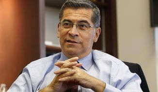 In this Oct. 10, 2018, file photo, California Attorney General Xavier Becerra discusses various issues during an interview with The Associated Press, in Sacramento, Calif. (AP Photo/Rich Pedroncelli)