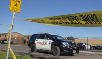 Crime scene tape surrounds the Pointe Ann Apartments in Texas City on Friday, Jan. 4, 2019,  where multiple children were found dead and a woman was shot in Texas City, Texas. Texas City Police said Junaid Hashim Mehmood surrendered and was taken into custody in connection to the crime Thursday night. (Stuart Villanueva/The Galveston County Daily News via AP)