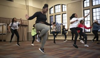 Students perform a dance routine as part of auditions at the Mosaic Youth Theater of Detroit,  on Thursday, Jan.  3, 2019. The theater recently received a gift of $1 million Hamilton producer and Oak Park native Jeffrey Seller.  (David Guralnick/Detroit News via AP)