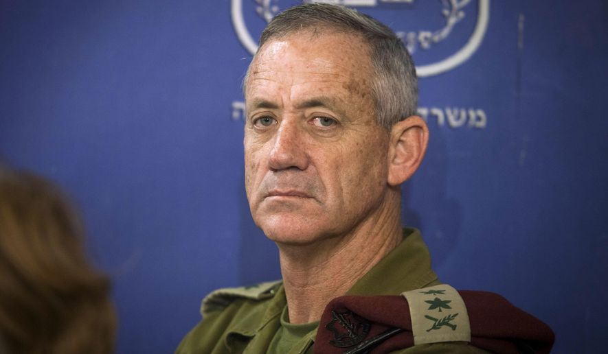 In this July 31, 2014 file photo, then Chief of General Staff of the Israel Defense Forces Lt. Gen. Benny Gantz attends a cabinet meeting at the defense ministry in Tel Aviv, Israel. (AP Photo/Dan Balilty, Pool, File)