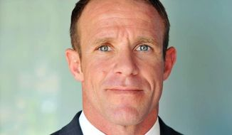 This 2018 photo provided by Andrea Gallagher shows her husband, Navy SEAL Edward Gallagher. The decorated Navy SEAL is facing charges of premediated murder and other offenses in connection with the fatal stabbing of a teenage Islamic State prisoner under his care in Iraq in 2017 and the shooting of unarmed Iraqi civilians. His attorney says he will plead not guilty to all the charges at a Naval hearing Friday, Jan. 4, 2019, in San Diego. (Andrea Gallagher via AP)