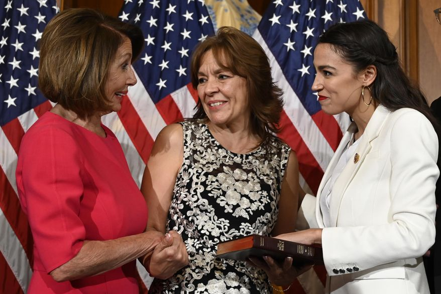 House Speaker Nancy Pelosi of Calif., left, talks with Rep. Alexandria Ocasio-Cortez, D-N.Y., right, and her mother Blanca Ocasio-Cortez, center, during a ceremonial swearing-in on Capitol Hill in Washington, Thursday, Jan. 3, 2019, during the opening session of the 116th Congress. (AP Photo/Susan Walsh) ** FILE **