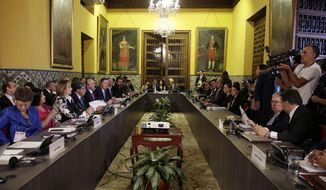 Foreign Ministers of the Lima Group gather for a meeting concerning Venezuela, in Lima, Peru, Friday, Jan. 4, 2019. The group gathers in Lima to define a strategy for resolving Venezuela's growing crisis ahead of President Nicolas Maduro's Jan. 10 inauguration to a second term, which is widely dismissed as illegitimate. (AP Photo/Martin Mejia)