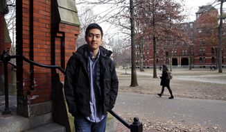 Harvard University graduate Jin K. Park, who holds a degree in molecular and cellular biology, poses at Harvard Yard in Cambridge, Mass., Thursday, Dec. 13, 2018.  Park, who was named a Rhodes Scholar along with 30 other Americans in November, entered the U.S. illegally as a child, moving to Queens borough of New York City with his family. The undocumented student, who participates in the Deferred Action for Childhood Arrivals program (DACA), is not sure if he'll be allowed back in the U.S. after his studies in the United Kingdom. (AP Photo/Charles Krupa)