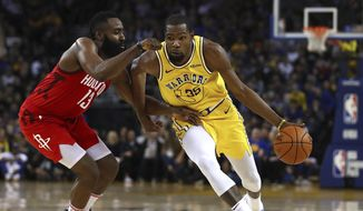 Houston Rockets' James Harden, left, guards Golden State Warriors' Kevin Durant during the second half of an NBA basketball game Thursday, Jan. 3, 2019, in Oakland, Calif. (AP Photo/Ben Margot) **FILE**