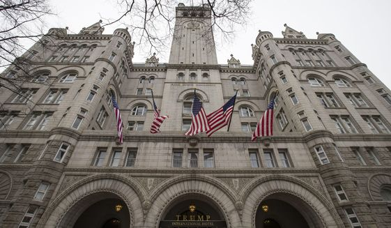 The Old Post Office Pavilion Clock Tower, which remains open during the partial government shutdown, is seen above the Trump International Hotel, Friday, Jan. 4, 2019 in Washington. (AP Photo/Alex Brandon)