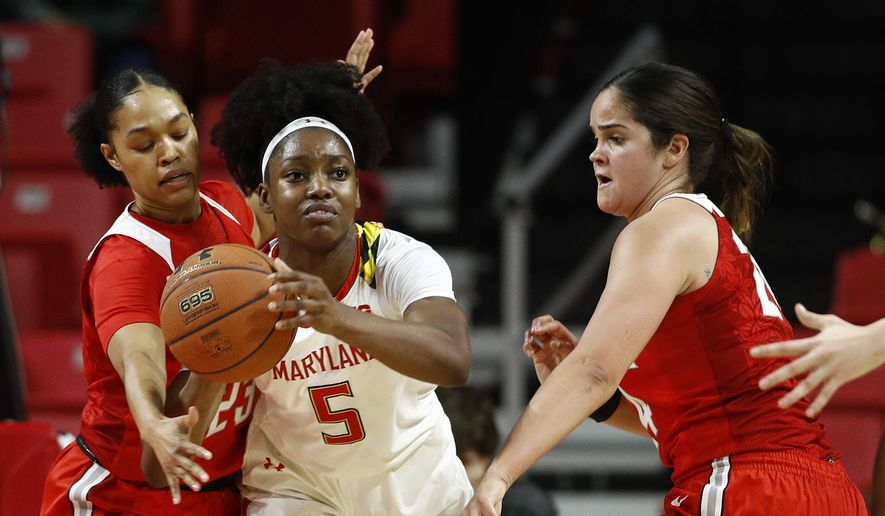 Maryland guard Kaila Charles, center, looks for a teammate as she is pressured by Ohio State guard Najah Queenland, left, and forward Makayla Waterman in the first half of an NCAA college basketball game, Saturday, Jan. 5, 2019, in College Park, Md. (AP Photo/Patrick Semansky) **FILE**