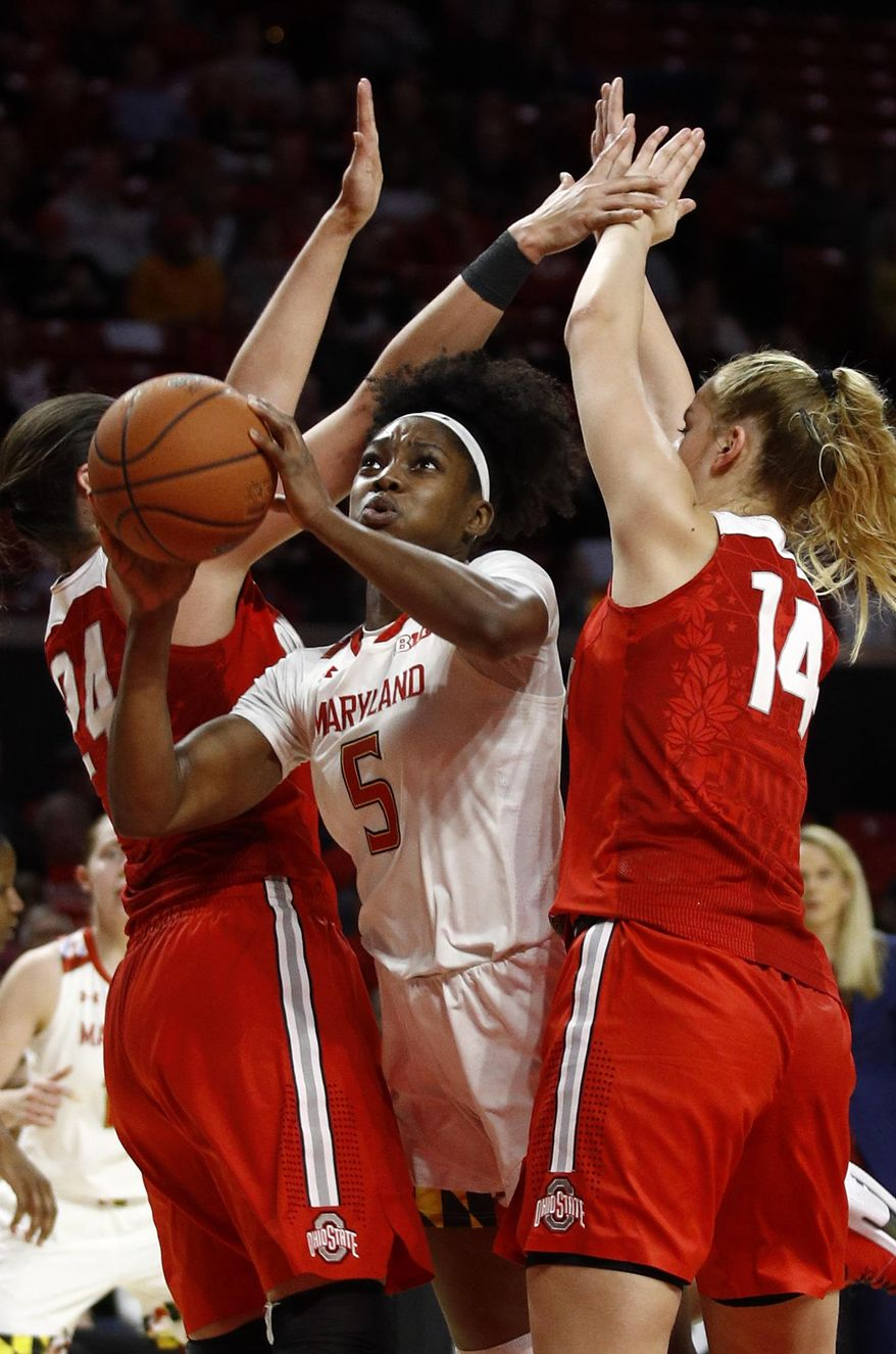 Maryland guard Kaila Charles, center, shoots between Ohio State forwards Makayla Waterman, left, and Dorka Juhasz, of Hungary, in the second half of an NCAA college basketball game, Saturday, Jan. 5, 2019, in College Park, Md. (AP Photo/Patrick Semansky) **FILE**