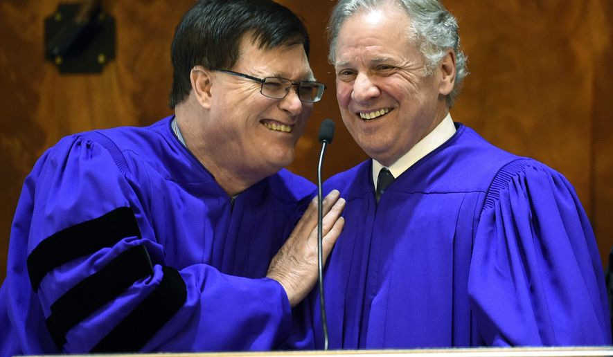 FILE - In this Feb. 4, 2015 file photo, Speaker of the House Jay Lucas, R-Darlington, left, and Lt. Gov. Henry McMaster share a laugh during a joint session of South Carolina legislature at the Statehouse in Columbia, S.C. The 2019 South Carolina Legislature's session starts Tuesday, Jan. 8 with a promise to overhaul the education system in South Carolina and about an extra $1 billion to spend.  (AP Photo/Rainier Ehrhardt, File)