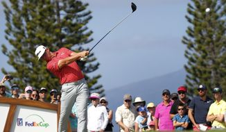 Gary Woodland plays his shot from the third tee during the third round of the Tournament of Champions golf event, Saturday, Jan. 5, 2019, at Kapalua Plantation Course in Kapalua, Hawaii. (AP Photo/Matt York)