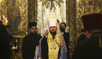 "Metropolitan Epiphanius, the head of the independent Ukrainian Orthodox Church, center, arrives to attend a meeting to sign ""Tomos"" decree of autocephaly for Ukrainian church at the Patriarchal Church of St. George in Istanbul, Turkey, Saturday, Jan. 5, 2019. (AP Photo/Emrah Gurel)"