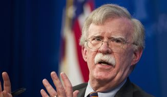 In this Dec. 13, 2018, file photo, National Security Adviser John Bolton unveils the Trump Administration's Africa Strategy at the Heritage Foundation in Washington. The White House has sent Bolton on a mission to allay Israel's concerns about President Donald Trump's decision to withdraw U.S. troops from Syria. The pullout announced before Christmas was initially expected to be completed within weeks, but the timetable has slowed as the president acceded to requests from aides, allies and members of Congress for a more orderly drawdown. (AP Photo/Cliff Owen)