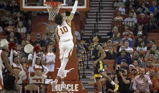Texas forward Jaxson Hayes (10) blocks a shot by West Virginia guard James Bolden (3) during an NCAA college basketball game on Saturday, Jan. 5, 2019, in Austin, Texas. (Nick Wagner/Austin American-Statesman via AP)