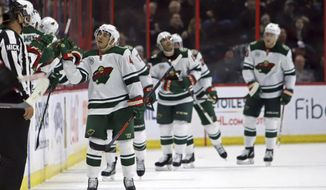 Minnesota Wild's Jared Spurgeon, left, celebrates scoring against the Ottawa Senators  during the second period of an NHL hockey game in Ottawa, Saturday, Jan. 5, 2019. (Fred Chartrand/The Canadian Press via AP)