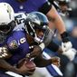Baltimore Ravens quarterback Lamar Jackson is sacked by Los Angeles Chargers defensive end Melvin Ingram in the second half of Sunday's AFC wild card game. The Ravens lost, 23-17. (ASSOCIATED PRESS)