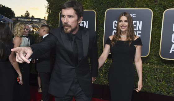 Christian Bale, left, gestures as he and Sibi Blazic arrive at the 76th annual Golden Globe Awards at the Beverly Hilton Hotel on Sunday, Jan. 6, 2019, in Beverly Hills, Calif. (Photo by Jordan Strauss/Invision/AP)
