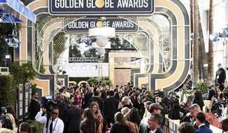 Media set up on the red carpet at the 76th annual Golden Globe Awards at the Beverly Hilton Hotel on Sunday, Jan. 6, 2019, in Beverly Hills, Calif. (Photo by Jordan Strauss/Invision/AP)