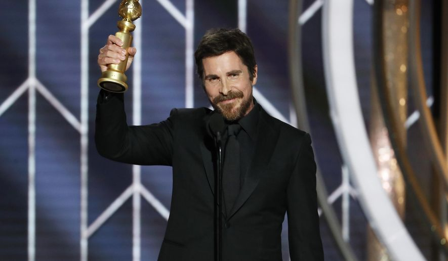 "This image released by NBC shows Christian Bale accepting the award for best actor in motion picture musical or comedy for his role in ""Vice"" during the 76th Annual Golden Globe Awards at the Beverly Hilton Hotel on Sunday, Jan. 6, 2019, in Beverly Hills, Calif. (Paul Drinkwater/NBC via AP)"