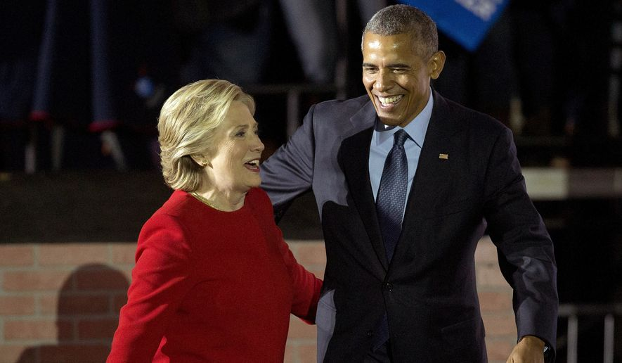 President Barack Obama and Democratic presidential candidate Hillary Clinton walk off stage after both spoke at a rally at Independence Mall in Philadelphia. Monday, Nov. 7, 2016. (AP Photo/Pablo Martinez Monsivais)