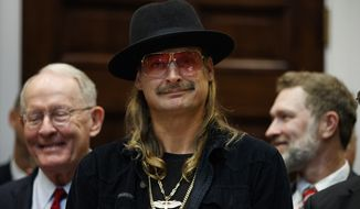 "Musician Kid Rock listens as President Donald Trump speaks during a signing ceremony for the ""Orrin G. Hatch-Bob Goodlatte Music Modernization Act,"" in the Roosevelt Room of the White House, Thursday, Oct. 11, 2018, in Washington. (AP Photo/Evan Vucci)"