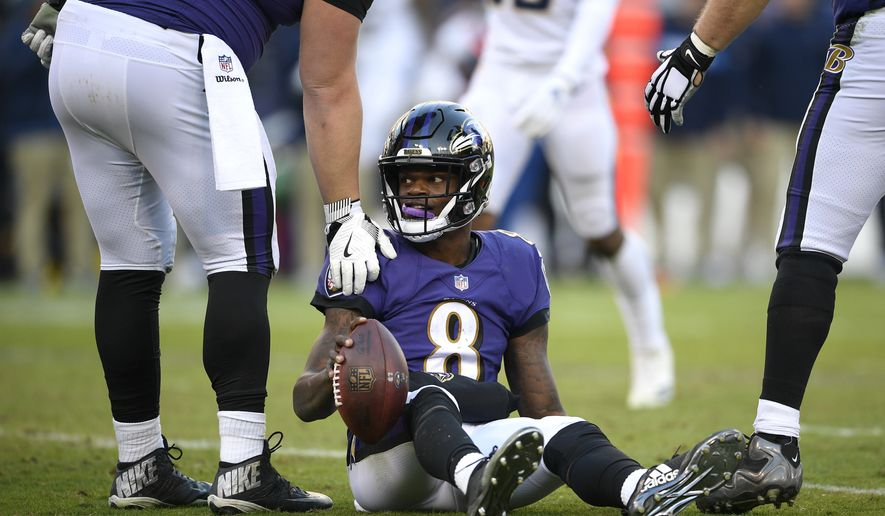 Baltimore Ravens quarterback Lamar Jackson (8) is assisted to his feet after a play in the second half of an NFL wild card playoff football game against the Los Angeles Chargers, Sunday, Jan. 6, 2019, in Baltimore. (AP Photo/Nick Wass)
