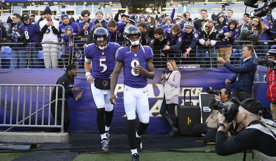 2ef99719 Baltimore Ravens quarterbacks Lamar Jackson (8) and Joe Flacco walk onto  the field before