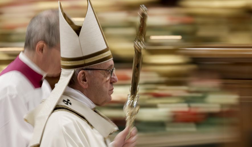 """In this photo taken with slow shutter speed Pope Francis leaves after celebrating an Epiphany Mass in St. Peter's Basilica at the Vatican, Sunday, Jan. 6, 2019. Pope Francis has appealed to European leaders to show """"concrete solidarity"""" to 49 migrants stranded aboard a pair of rescue vessels. Francis, addressing faithful in St. Peter's Square Sunday, noted that the migrants, rescued in the Mediterranean.  (AP Photo/Andrew Medichini)"""