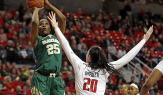 Baylor's Queen Egbo (25) shoots over Texas Tech's Brittany Brewer (20) during the second half of an NCAA college basketball game Sunday, Jan. 6, 2019, in Lubbock, Texas. (Brad Tollefson/Lubbock Avalanche-Journal via AP)