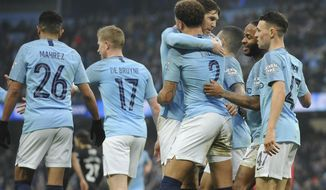 Manchester City's Kyle Walker, No 2, celebrates with teammates after Rotherham's Semi Ajayi scored an own goal during the English FA Cup third round soccer match between Manchester City and Rotherham United at Etihad stadium in Manchester, England, Sunday, Jan. 6, 2019. (AP Photo/Rui Vieira)