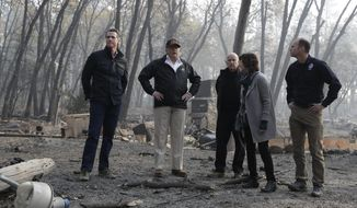In this Nov. 17, 2018, photo, President Donald Trump talks with from left, Gov.-elect Gavin Newsom, FEMA Administrator Brock Long, right, Jody Jones, Mayor of Paradise, and California Gov. Jerry Brown during a visit to a neighborhood impacted by the wildfires, in Paradise, Calif. Newsom who will be sworn into office Jan. 7, 2019, has been a harsh critic of Trump. (AP Photo/Evan Vucci) **FILE**