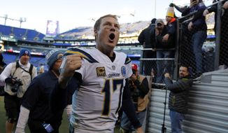 Los Angeles Chargers quarterback Philip Rivers celebates as he walks off the field after an NFL wild card playoff football game against the Baltimore Ravens, Sunday, Jan. 6, 2019, in Baltimore. Los Angeles won 23-17. (AP Photo/Carolyn Kaster)