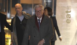U.S. Undersecretary of Commerce for International Trade Gilbert B. Kaplan arrives as part of a trade delegation at a hotel in Beijing, China, Sunday, Jan. 6, 2019. The U.S. delegation led by deputy U.S. trade representative, Jeffrey D. Gerrish arrived in the Chinese capital ahead of trade talks with China,(AP Photo/Ng Han Guan)