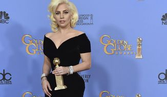 "FILE - In this Jan. 20, 2016 file photo, Lady Gaga poses in the press room with the award for best performance by an actress in a limited series or a motion picture made for TV for ""American Horror Story: Hotel"" at the 73rd annual Golden Globe Awards at the Beverly Hilton Hotel in Beverly Hills, Calif.  Lady Gaga is poised to win not just one but two awards when the 76th annual Golden Globes get under way Sunday, Jan. 6, 2019.  (Photo by Jordan Strauss/Invision/AP)"