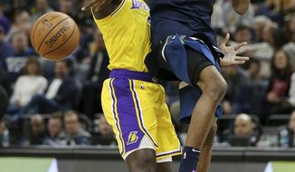 Minnesota Timberwolves' Andrew Wiggins tries to pass the ball over Los Angeles Lakers' Lance Stephenson in the first half of an NBA basketball game Sunday, Jan. 6, 2019, in Minneapolis. (AP Photo/Stacy Bengs)