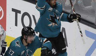 San Jose Sharks left wing Evander Kane celebrates after scoring a goal against the Tampa Bay Lightning during the third period of an NHL hockey game in San Jose, Calif., Saturday, Jan. 5, 2019. (AP Photo/Jeff Chiu)
