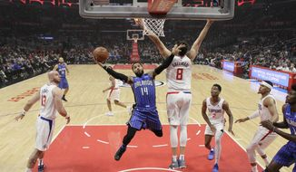 Orlando Magic's D.J. Augustin (14) drives to the basket as Los Angeles Clippers' Danilo Gallinari (8) defends during the first half of an NBA basketball game Sunday, Jan. 6, 2019, in Los Angeles. (AP Photo/Marcio Jose Sanchez)