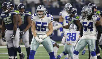 Dallas Cowboys Dallas Leighton Vander Esch (55) and Jaylon Smith (54) celebrate a defensive play against the Seattle Seahawks during the second half of the NFC wild-card NFL football game, in Arlington, Texas, Saturday, Jan. 5, 2019. (AP Photo/Ron Jenkins)