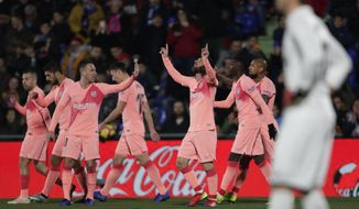 FC Barcelona's Lionel Messi celebrates after scoring during a Spanish La Liga soccer match between Getafe and FC Barcelona at the Alfonso Perez stadium in Getafe, Spain, Sunday, Jan. 6, 2019. (AP Photo/Manu Fernandez)