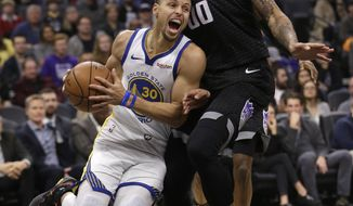Golden State Warriors guard Stephen Curry, left, drives against Sacramento Kings center Willie Cauley-Stein during the first quarter of an NBA basketball game, Saturday, Jan. 5, 2019, in Sacramento, Calif. (AP Photo/Rich Pedroncelli)