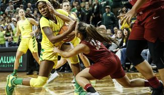 Oregon forward Ruthy Hebard (24) battles for the ball against Washington State guard Cherilyn Molina (33) during an NCAA college basketball game Sunday, Jan. 6, 2019, in Eugene, Ore. (AP Photo/Thomas Boyd)