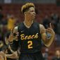 Long Beach State guard Nick Faust celebrates after sinking a three shot during the second half of an NCAA college basketball game against UC Irvine won by Long Beach State 77-22 at the Big West conference tournament Friday March 11, 2016, in Anaheim, Calif. (AP Photo/Lenny Ignelzi)