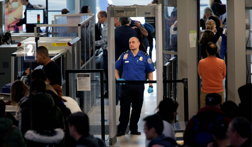 Transportation Security Administration agents are among 420,000 federal employees who have been working without pay during the shutdown. (Associated Press)