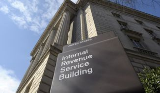 In this photo March 22, 2013 file photo, the exterior of the Internal Revenue Service (IRS) building in Washington. House Democrats have given the agency until April 23, 2019, to  hand over President Trump's tax returns. (AP Photo/Susan Walsh, File) **FILE**